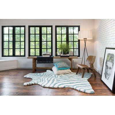 Zebra Stripe Hand-Tufted�Faux Cowhide Ivory/Turquoise Area Rug Rug Size: Novelty 5 x 76