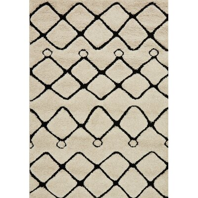 Enchant Beige/Black Area Rug Rug Size: Rectangle 310 x 57