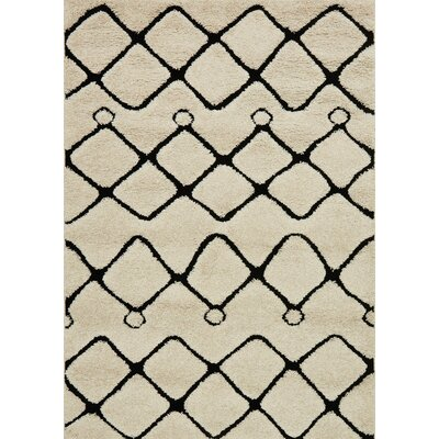 Enchant Beige/Black Area Rug Rug Size: 23 x 39