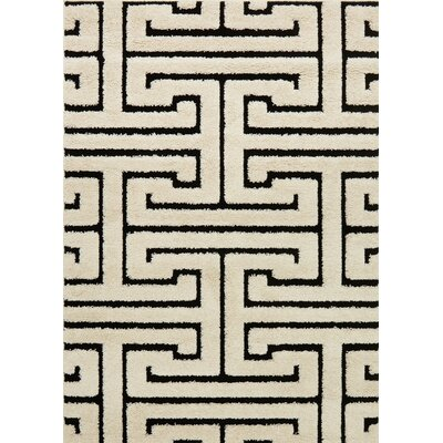 Enchant Beige/Black Area Rug Rug Size: 77 x 106