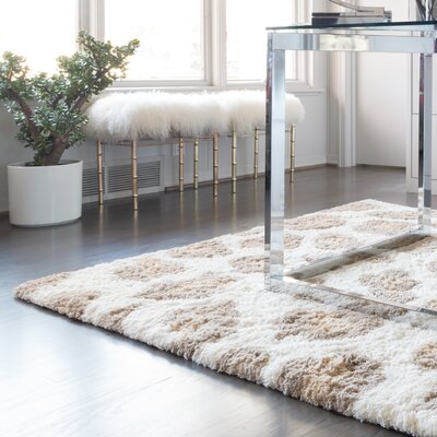 Change Your Spots Ivory Rug Rug Size: 2'3