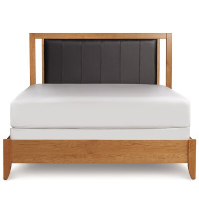 Dominion Upholstered Bed Size: King, Upholstery: Coffee, Finish: Natural Cherry