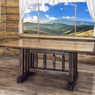 Abella Dining Table Trestle Based Finish: Stained and Lacquered