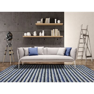 Brookes Hand-Tufted Blue Area Rug Rug Size: 76 x 96