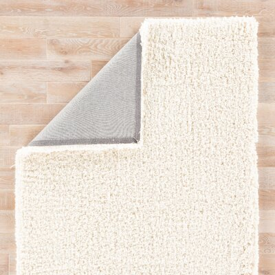 Nixon Hand Tufted Cream Area Rug