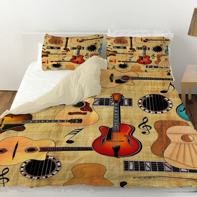 Guitar Collage Cream Duvet Cover Size: King