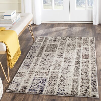 Mercado Beige Area Rug Rug Size: Rectangle 4 x 57