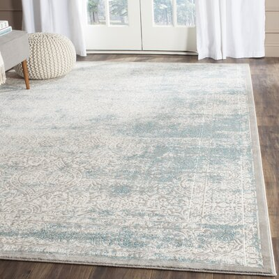 Auguste Turquoise/Ivory Area Rug Rug Size: Rectangle 9' x 12'