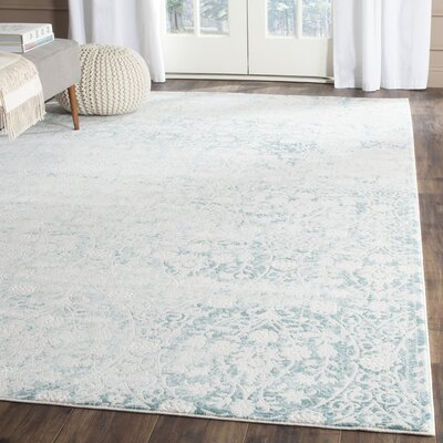 Auguste Turquoise/Ivory Area Rug Rug Size: Rectangle 8 x 11