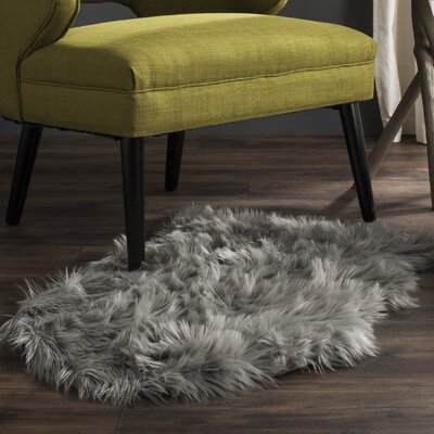 Isacc Faux Sheepskin Grey Area Rug Rug Size: 6 x 9