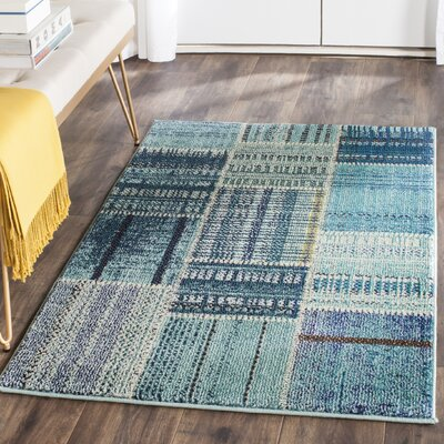 Damien Blue Area Rug Rug Size: Rectangle 51 x 77