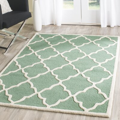 Charlenne Hand-Tufted Teal/Ivory Area Rug Rug Size: Rectangle 5 x 8