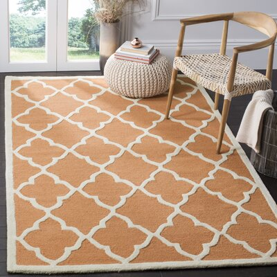 Charlenne Hand-Tufted Orange/Ivory Area Rug Rug Size: Rectangle 5 x 8