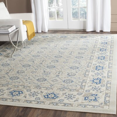 Patina Light Blue/Ivory Area Rug Rug Size: Rectangle 4 x 6