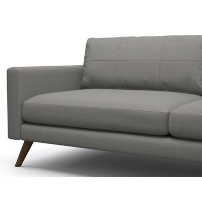 Dane Corner Sectional with Bumper Body Fabric: Klein Dove, Leg Finish: Honey, Sectional Orientation: Left Facing