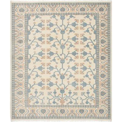 Stonewash Ushak Hand-Woven Cream Area Rug Rug Size: 84 x 101
