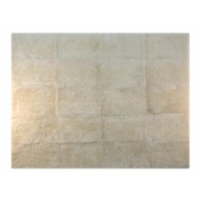 Patagonia Sheepskin Natural Ivory Area Rug Rug Size: Rectangle 5 x 75