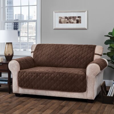 Logan with Straps T-Cushion Sofa Slipcover Size: 0.25 H x 110 W x 75.5 D, Upholstery: Chocolate