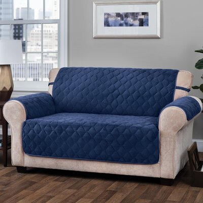 Logan with Straps T-Cushion Sofa Slipcover Size: 0.25 H x 110 W x 75.5 D, Upholstery: Navy
