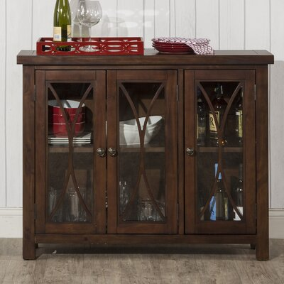 Sierra Madre 3 Door Accent Cabinet Color: Mahogany