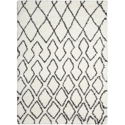 Riad Ivory/Black Area Rug Rug Size: Rectangle 53 x 73