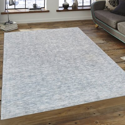 Transitiona Hand Loomed Ivory Area Rug