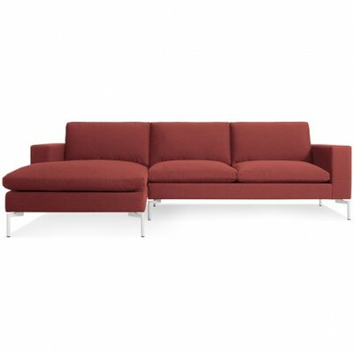The New Standard Sectional Upholstery: Nixon Red, Leg Finish: White