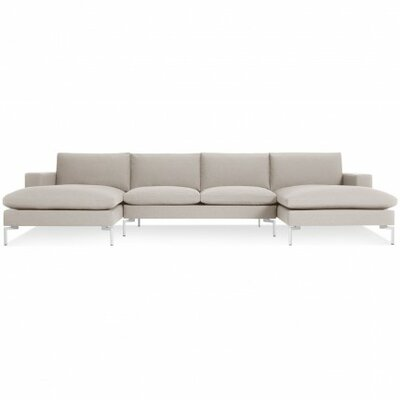 The New Standard Sectional Collection Body Fabric: Nixon Sand, Leg Finish: White