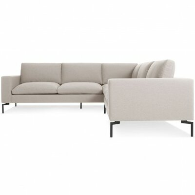 The New Standard Sectional Collection Body Fabric: Nixon Sand, Leg Finish: Black, Orientation: Right hand facing