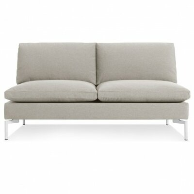 The New Standard Armless Loveseat Upholstery: Nixon Sand, Leg Finish: White