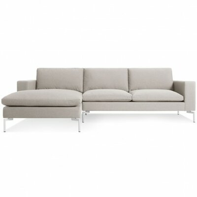 The New Standard Sectional Collection Body Fabric: Nixon Sand, Leg Color: White