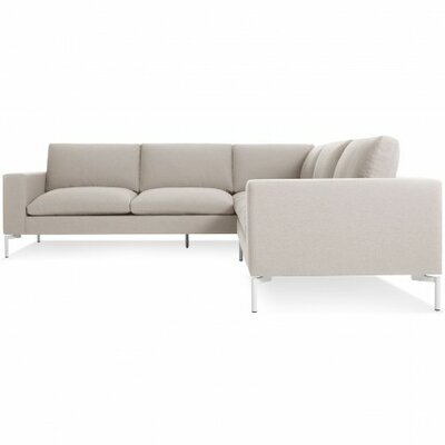 The New Standard Sectional Collection Body Fabric: Nixon Sand, Leg Finish: White, Orientation: Right hand facing