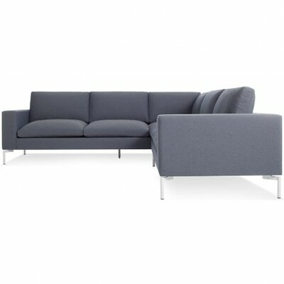 The New Standard Sectional Collection Body Fabric: Nixon Blue, Leg Color: White, Orientation: Right hand facing