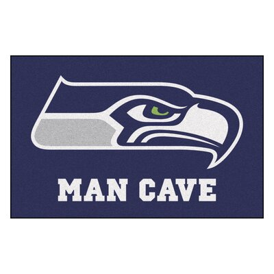 NFL - Seattle Seahawks Man Cave Starter Rug Size: 17 x 26