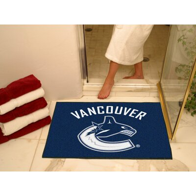 NHL - Vancouver Canucks Doormat Rug Size: 5 x 8