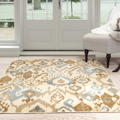 Ikat Cream & Blue Area Rug Rug Size: 5 x 77