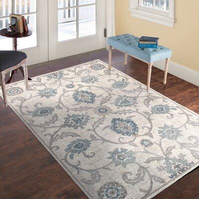 Ivory/Brown Area Rug Rug Size: 5 x 77