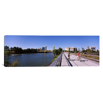 Panoramic Bicyclists along the River Sacramento, California Photographic Print on Canvas Size: 16