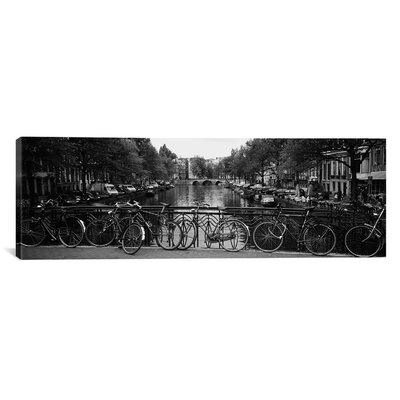 Panoramic Bicycle Leaning Against a Metal Railing Print on Canvas Size: 16