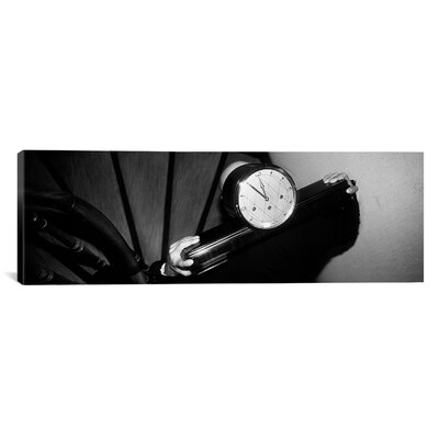 Panoramic Man Carrying Clock up Stairs on Shoulders Photographic Print on Canvas Size: 12