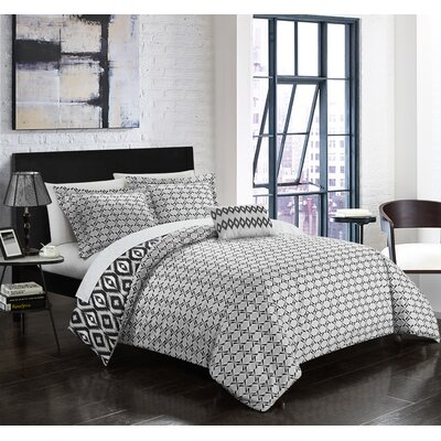 Trang 4 Piece Reversible Duvet Set Color: Black, Size: Queen