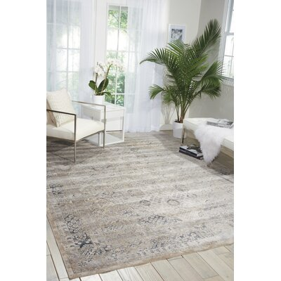 Malta Ivory/Blue Area Rug Rug Size: Rectangle 77 x 1010