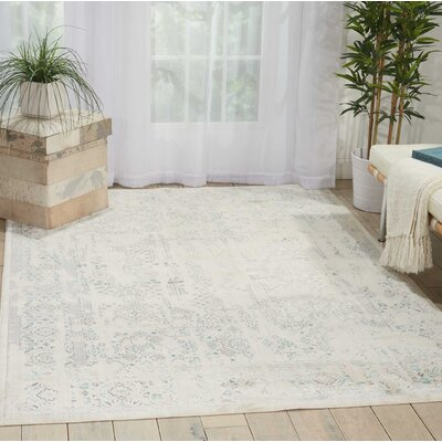 Silver Screen Ivory/Teal Area Rug Rug Size: Rectangle 910 x 132
