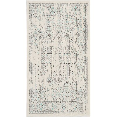 Silver Screen Ivory/Teal Area Rug Rug Size: Rectangle 22 x 39