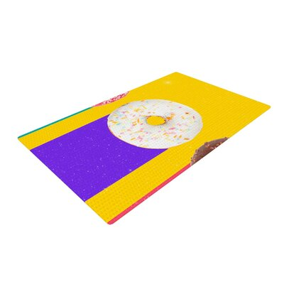 Danny Ivan Donuts Yellow/Purple Area Rug Rug Size: 2 x 3