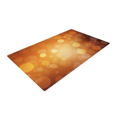 Sunrise Bokeh Orange Area Rug Rug Size: 4 x 6