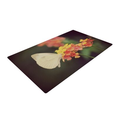 Robin Dickinson Captivating Flower Orange Area Rug