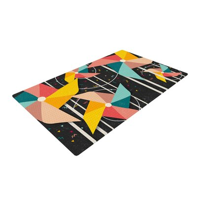 Danny Ivan Colorful Pinwheels Abstract Black Area Rug