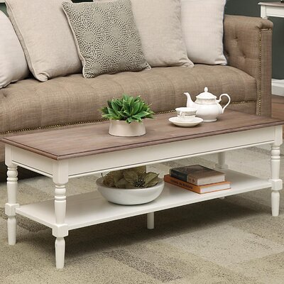 Callery Coffee Table with Magazine Rack Base Finish: Driftwood, Top Finish: White