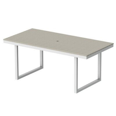 Kinzie Outdoor Modern Dining Table Base Finish: Textured White Frame, Top Finish: Sand